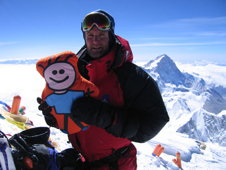 Image: Tony with the Red Cross mascot at the summit