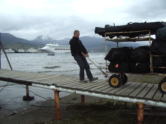 Image: Andrew Wall a.k.a. Arnie drags a load of climbing gear towards the boat