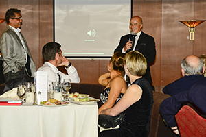 Image: Erden on the stage during the Cruise, introducing Joseph Anaya.