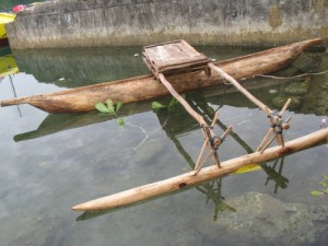Image: The dugout canoes had a pontoon on the side held in place by cross beams and sticks tied together by twine.