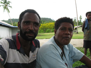 Image: Philip and Eva from Kamlawa Village became my friends who worried and cared for my well being while my rowboat was tied at the Maneba Wharf in Finsch Harbor.
