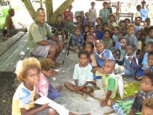 Image: With the K-2 grade children gathered at the school during our visit.