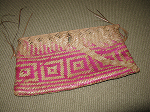 Image: A grandmother offered me this hand woven bag that she had made from coconut tree leaves.