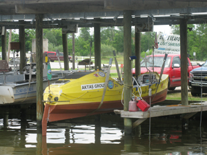 Image: I left my rowboat in the shade in a boat stall.