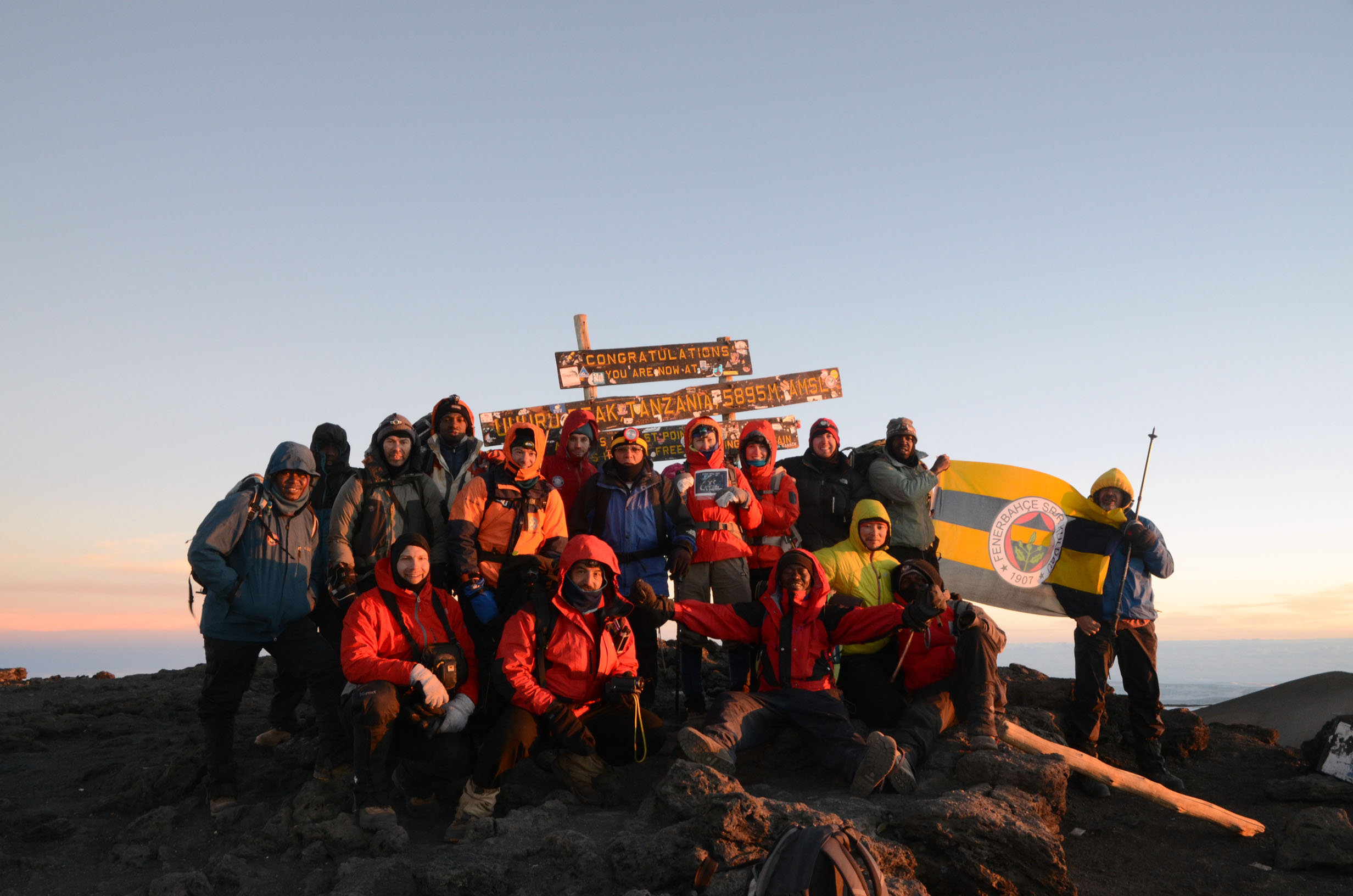 Image: Team Around-n-Over on the summit